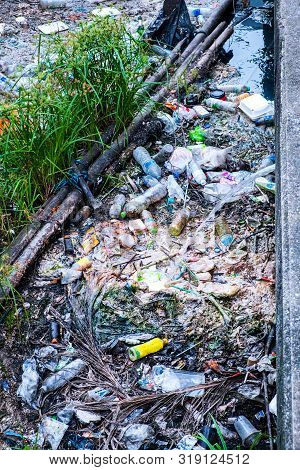 Ecology Watercourse River Canal With Garbage And Plastic Inside City