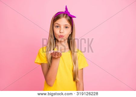 Photo Of Pupil Girl Of Primary School Sending Kiss To Someone Unseen While Isolated With Pink Backgr
