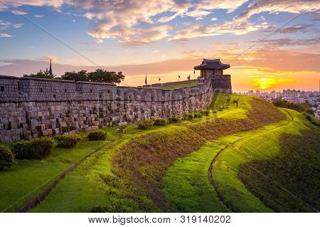 Korea Landmark And Park After Sunset, Traditional Architecture At Suwon, Hwaseong Fortress In Sunset