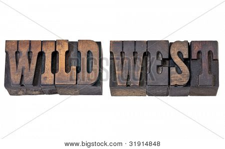 wild west - isolated text in vintage letterpress wood type - French Clarendon font popular in western movies and memorabilia