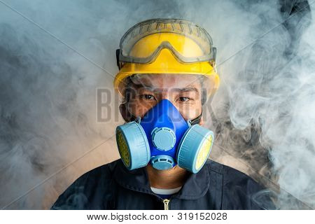 A Rescue Worker Wears A Respirator In A Smokey, Toxic Atmosphere. Image Show The Importance Of Prote