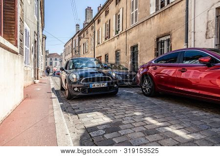 France Beaune 2019-06-19 New Shiny Car Mini Cooper S Parking On Cozy European Street With Paving Sto