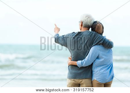 Asian Lifestyle Senior Couple Hug On The Beach Happy In Love Romantic And Relax Time.  Tourism Elder