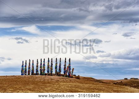 Sacred Buryat Place On Olkhon Island With Beautiful Sky And Clouds, Lake Baikal, Russia