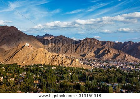 View of Leh town with Namgyal Tsemo gompa (Tibetan Buddhist monastery) and ruins of Namgyal Tsemo fort. Leh, Ladakh, India