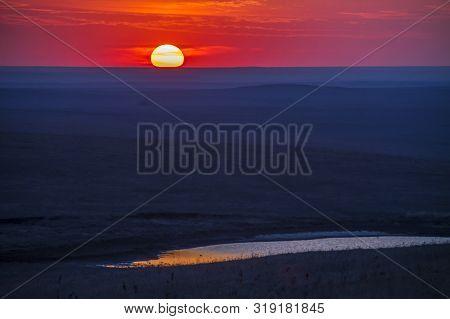 Sunset Over The Flint Hills Of Kansas; Small Pond Reflection