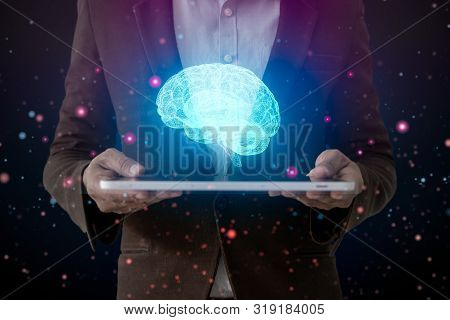 Human Hand Holding Tablet And Brain, Ai (artificial Intelligence)technology, Thinking Or Iot (intern