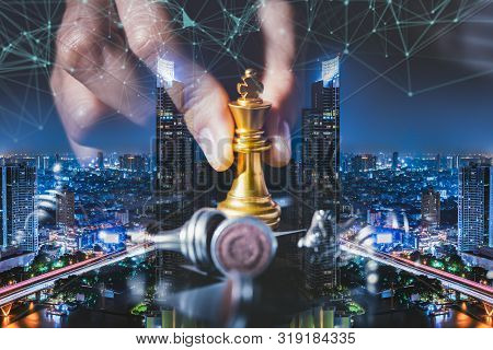 Business Strategy Ideas Concept With Chess Board Game On City Background.double Exposure Of The Busi