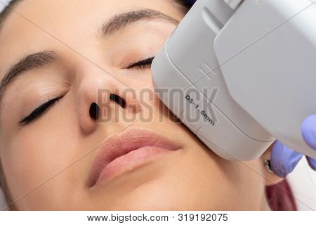 Woman Receiving High Intensity Focused Ultrasound Treatment On Face. Therapist Doing Cosmetic Plasma