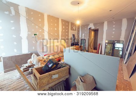Working Process Of Renovate Room With Installing Drywall Or Gypsum Plasterboard And Construction Mat