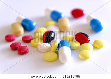 Biologically active additive. Handful of pills in his hand. Pharmacology of shadow production. Placebo. The problem of counterfeit drugs poster