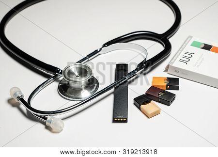 Morgantown, Wv - 27 August 2019: Juul E-cigarette Or Nicotine Vapor Dispenser Box On White With Stet