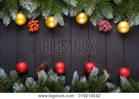 Christmas Dark Background With Christmas Decoration, Christmas Candy Canes, Christmas Balls And Fir