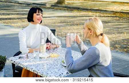 Female Friendship. Trustful Communication. Girls Friends Drink Coffee And Talk. Conversation Of Two