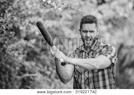 Man Unshaven Strict Face Hold Black Baseball Bat. Strong Temper. Principle Concept. Confident In His