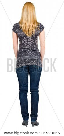 back view of standing beautiful blonde woman. Young girl in jeans . Rear view. Isolated over white background