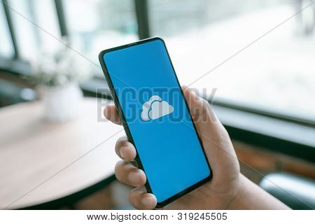 Chiang Mai, Thailand - Aug.24,2019: Man Holding Xiaomi Mi Mix 3 With Onedrive On Screen. Microsoft O