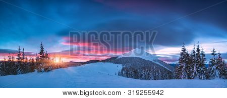 Alpine Mountain Valley Covered With Snow In A Light Of Sunrise. Majestic Winter Landscape.