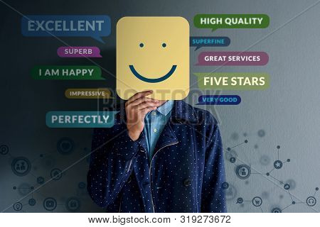 Customer Experience Concept. Happy Client Standing At The Wall With Smiling Face On Paper. Surrounde