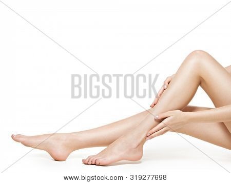 Beautiful female legs after depilation isolated on white