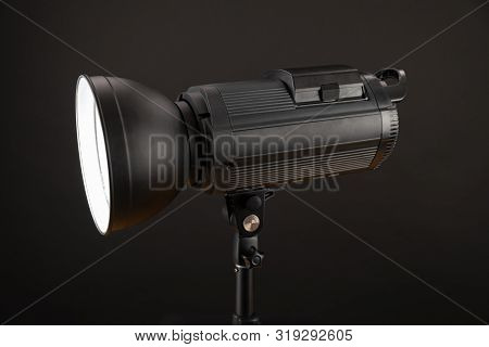 Head Of Studio Flash Strobe Lamp Light. Side View Professional Studio Photography Lighting Close Up