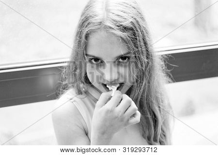 Chew Gum To Stay Numb. Cute Little Girl Chewing A Gum. Adorable Small Child Stretching White Bubble