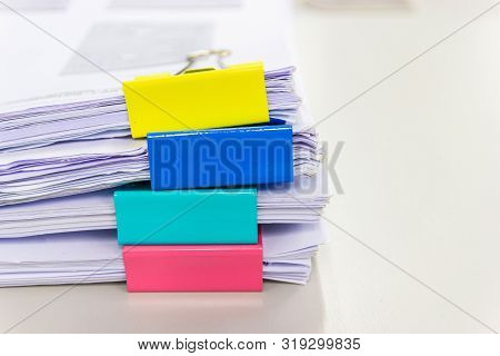 File Folder And Stack Of Business Report Paper File On The Table In A Work Office, Concept Document