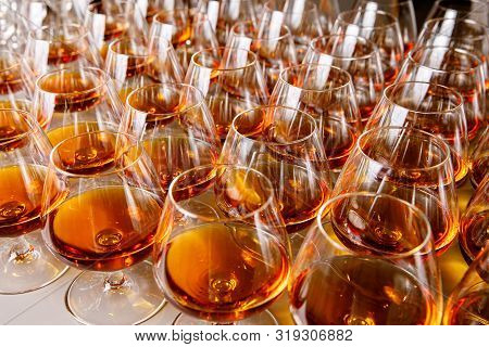 Stylish Glasses With Cognac Or Whiskey On Table At Event Catering