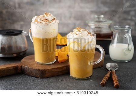 Two Glass Cups With Spice Pumpkin Cappuccino On Dark Grey Background