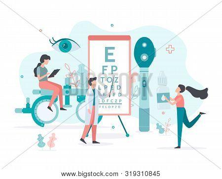Medical Team Checks Vision. Ophthalmologic Standing Near Eye Test Chart. The Nurse Carries Eye Drops