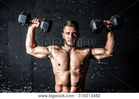 Shoulders Training, Young Strong Sweaty Man Shoulders Workout Training With Two Dumbbells In The Gym