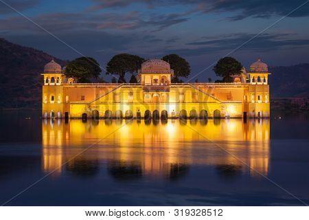 Rajasthan landmark - Jal Mahal (Water Palace) on Man Sagar Lake in the evening in twilight. Jaipur, Rajasthan, India