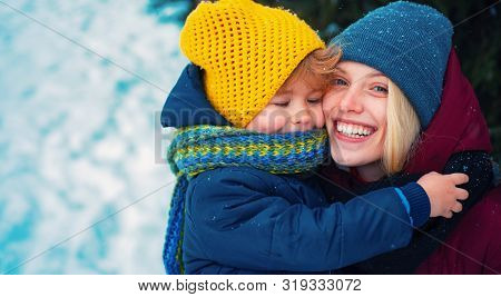 Happy Winter. Mom And Baby Warm Hat Scarf. Woman With Son Smiling Snowy Winter Nature Background. Ch