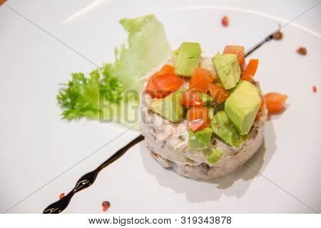A Tuna Mixed Salad With Avocado And Tomato