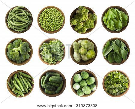 Vegetables Isolated On A White. Squash, Green Peas, Broccoli, Kale Leaves And Green Bean In Wooden B