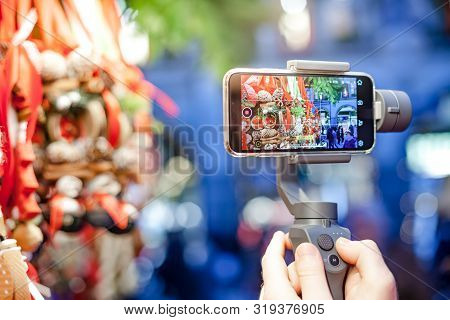 Germany, Munich - December 20, 2018: Close-up Of Man Blogger Hands Shooting Video On Smartphone Ipho