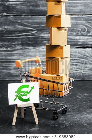 Trading Car With Boxes And An Easel With A Green Euro Symbol. Positive Trend. Advertising Sale, Mark