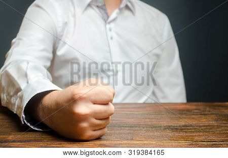 The Man Hit Slammed His Fist On The Table. The End Of Patience. It Is Impossible To Bear It. An Atta