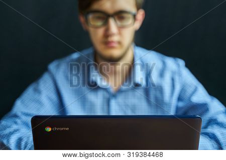 Bishkek, Kyrgyzstan - June 6, 2019: Asus Chromebook. Smart Young Businessman Working On Computer Lap
