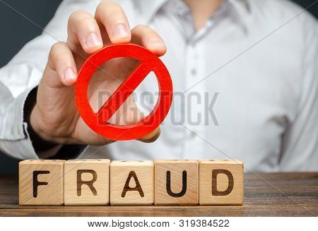A Man Holds A Red No Prohibition Symbol Over Word Fraud. Countering Deception, Protection Against Fr
