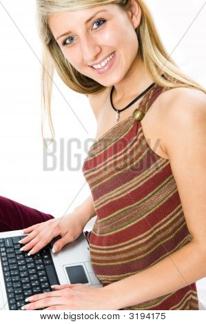 Beautiful girl with blonde hair using a laptop computer. Shot with Nikon D3. poster