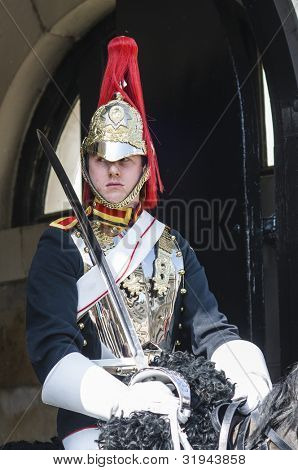 LONDON, UK - APRIL 02: Portrait of Royal Horse Guards in typical outfit. April 02, 2012 in London. The horseguard troopers carry out ceremonial duties and are the queens escort during state visits.