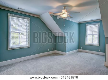 Empty upstairs attic bedroom with windows, place your own furniture.