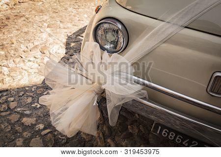 Malcesine, Lake Garda, Italy, August 2019, A Wedding Decoration On A Fiat 500 Bonnet