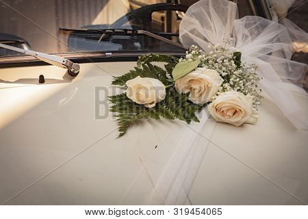 Malcesine, Lake Garda, Italy, August 2019, Some Wedding Flowers On A Fiat 500 Bonnet