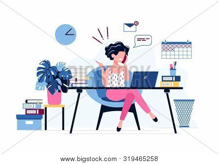 Annoyed Female Office Worker. Exhausted Businesswoman Uses Laptop, Speaks On The Phone Sitting At Th