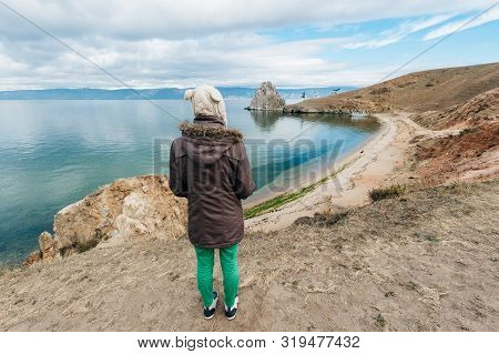 Girl On Rock Of Shamanka Burhan On Olkhon Island In Lake Baikal, Russia
