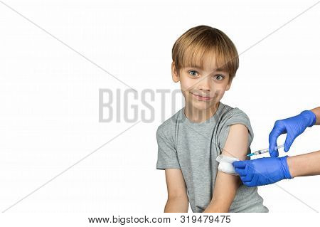 Caucasian Boy Has  A Hospital Appointment. Right  Arm Is The Site Of The Injection. He Is Don't  Afr