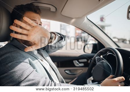 Young Driver Hides His Face And Looks Scared Because Of Dangerous Traffic Situation That Could Cause