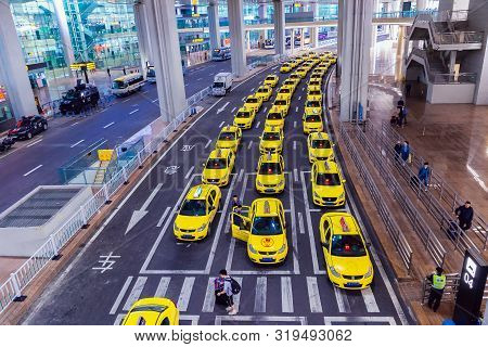Yubei, Chongqing - China, May 7, 2019 : Group Of Yellow Taxi Cabs Waiting Arrival Passengers In Fron